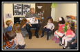 Author Andrew Zuckerman reads to kids for Int'l Book Giving Day.