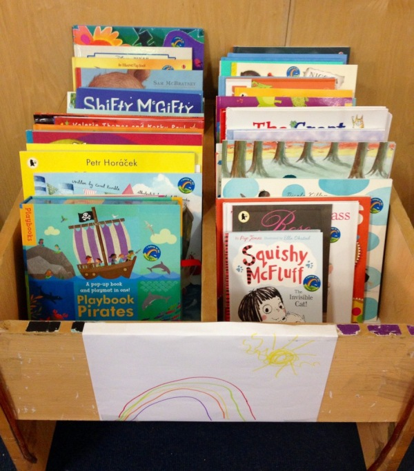 The Rainbow Library, thanks to Carmen Haselup. A wonderful idea! This is set up every year ... ready for International Book Giving Day. A wonderful collection of books, in a school, for children to choose ... and take home & keep.