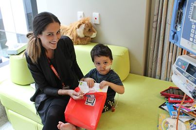 RCH Education Institute teachers shared their passion for reading today by presenting every inpatient with a book to celebrate International Book Giving Day 2014, with all books generously donated by Scholastic Australia.