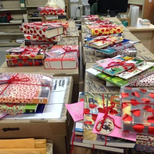 Angela Reynolds - piles of books all wrapped up ready for International Book Giving Day 2014.