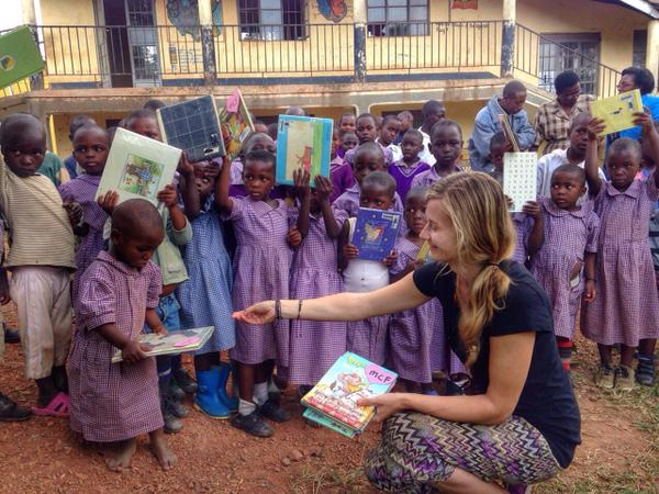 UGANDA: MCox Foundation presenting this student with her FIRST book.
